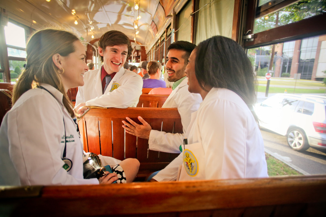 Medical students on street car